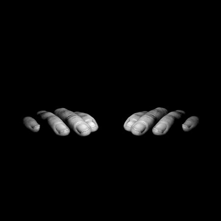 Black and white symetrical hands creeping on the edge isolated with black background Stock Photo - 731009