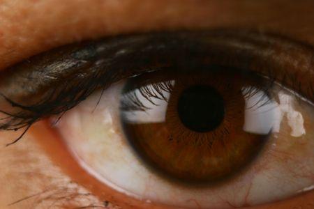 Extreme Close Up of human eye showing veins, pupils