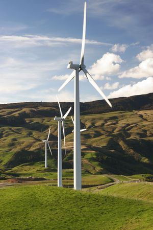 Wind farm on top of green hills