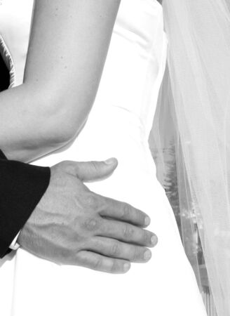 Bride with groom holding onto waist in black and white Stock Photo - 895734