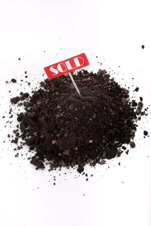 Sold sign and soil isolated on white background