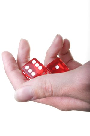 Hand with two red dice isolated on white background Stock Photo
