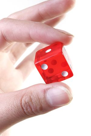 Hand with red dice isolated on white background