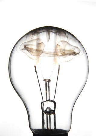 White lightbulb burningon a white background