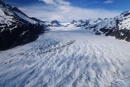 Glacier carving through mountainous landscape