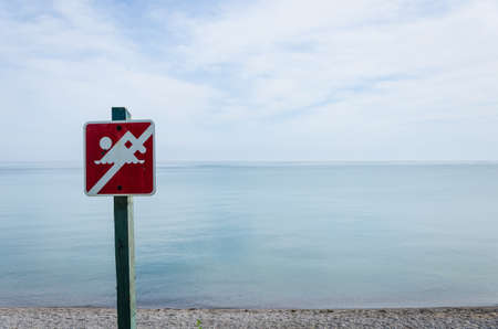 no swimming sign: No swimming sign on the beach
