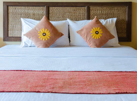 bed with Thai traditional headboard in hotel