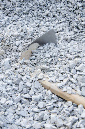 shovel under the pile of gravel photo