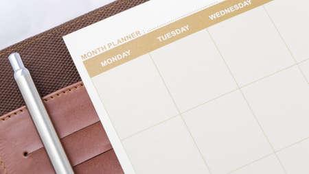 brown month planner book