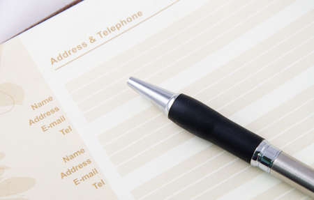 listings: brown address book with pen