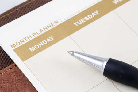 almanac: close up shot of brown planner book with pen Stock Photo