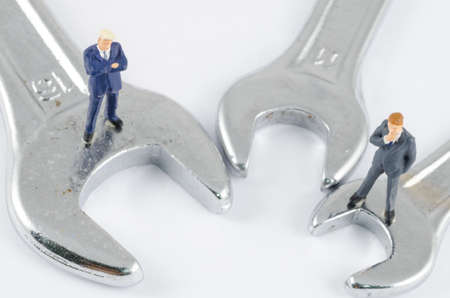 problem: miniature businessman standing on the wrench, Problem solving concept
