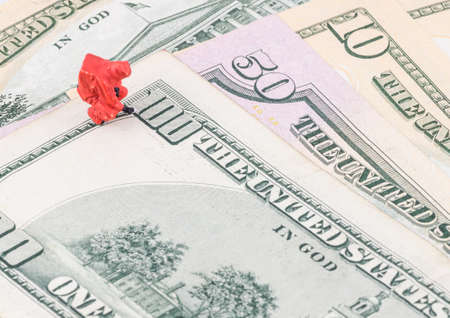 counterfeit: miniature specialist checking the counterfeit money
