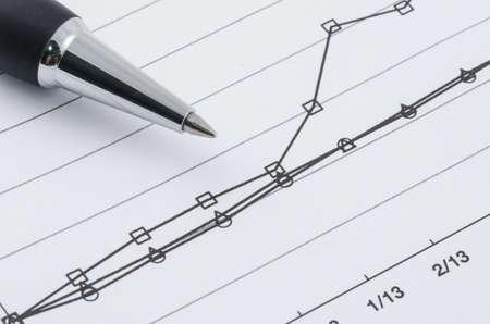 pen on the compare graph Banco de Imagens