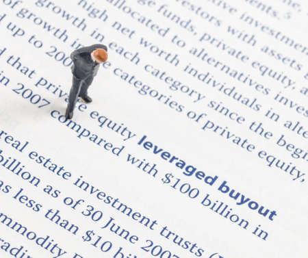 miniature businessman standing on the leveraged buyout strategy