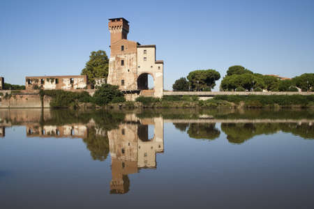 View of Guelph Tower and trees along the River Arno, Pisa Stock Photo - 12001783
