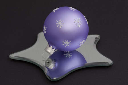 Christmas bauble reflected in a star shaped mirror