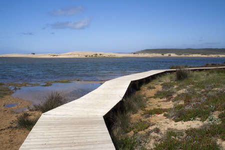 Bordeira Beach, Portugal, viewed from a wooden walkway
