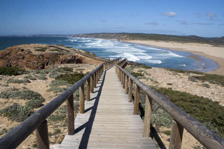 Bordeira Beach, Algarve, Portugal, viewed from a wooden walkway