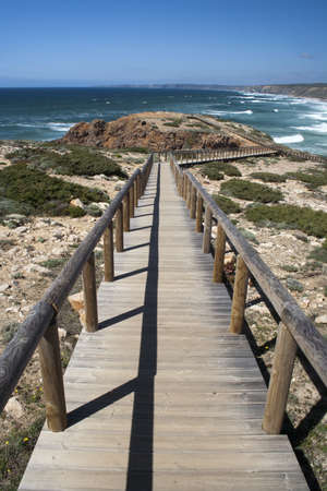 Promontory adjacent to Bordeira Beach, Portugal, viewed from a wooden walkway