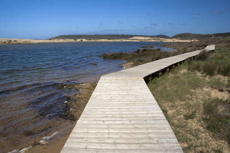 Bordeira Beach, on the west coast of the Algarve, viewed from a wooden walkway Stock Photo