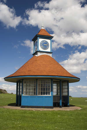 Clock tower and shelter on the greensward at Frinton, Essex, England Stock Photo - 13676814