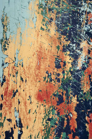 Closeup image showing the textures and colours of peeling paint