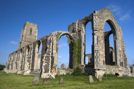 The present day Church of St Andrew, at Covehithe,  Suffolk, England, built within the shell of its  predecessor, now in ruins.
