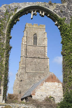 The present day Church of St Andrew, at Covehithe,  Suffolk, England, viewed through the arch of its predecessor, now in ruins  Stock Photo - 14252854
