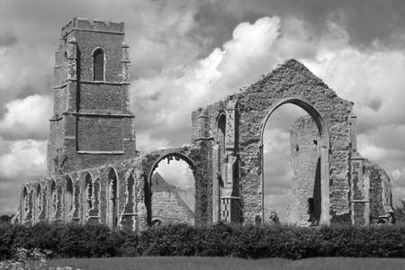 The present day Church of St Andrew, at Covehithe,  Suffolk, England, built within the shell of its predecessor, now in ruins