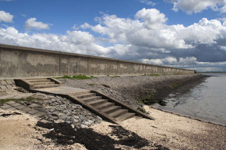 Sea wall and steps leading down to the beach on Canvey Island, Essex, England Stock Photo - 14299394