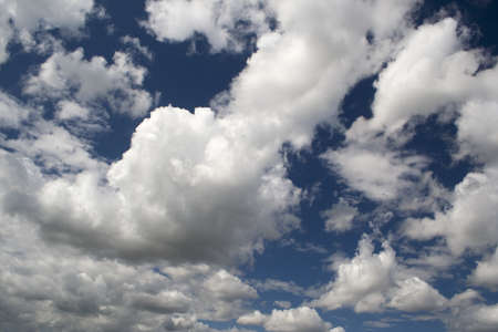 Blue sky with white and grey clouds Stock Photo - 14387128