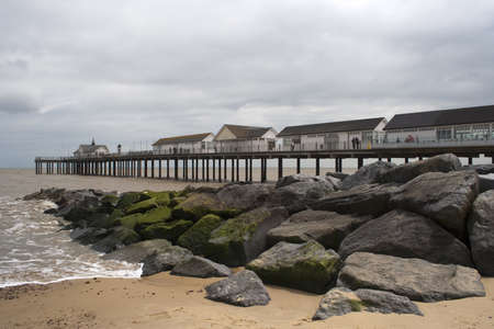 southwold: Breakwater in front of Southwold Pier, Suffolk, England on a grey day Stock Photo