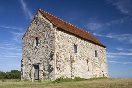 St Peter's-on-the-Wall Chapel, Bradwell-on-Sea, Essex, England, set on the site of the Roman fotress of Othona.  Stock Photo - 15315326