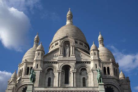 Sacre Coeur, Montmartre, Paris, France, against a blue sky.