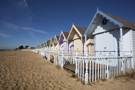 Beach Huts against a blue sky at West Mersea, Essex, England Stock Photo - 15393421