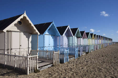 Beach Huts against a blue sky at West Mersea, Essex, England Stock Photo - 15393419