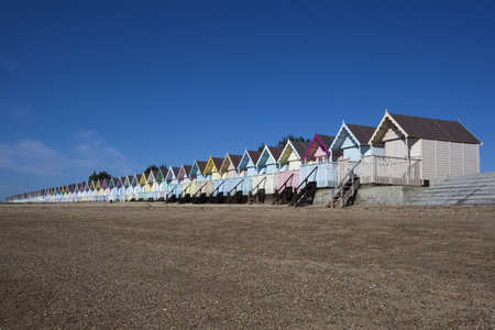 Beach Huts against a blue sky at West Mersea, Essex, England Stock Photo - 15393424