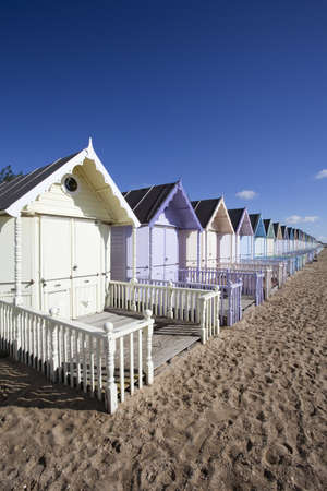 Beach Huts against a blue sky at West Mersea, Essex, England Stock Photo - 15393423