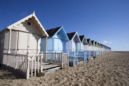 Beach Huts against a blue sky at West Mersea, Essex, England photo