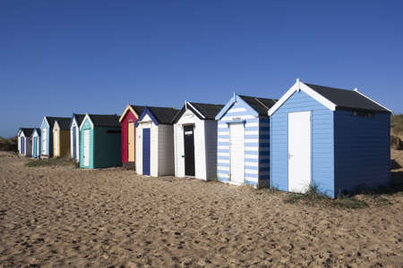 Beach Huts against a blue sky at Southwold, Suffolk , England Stock Photo