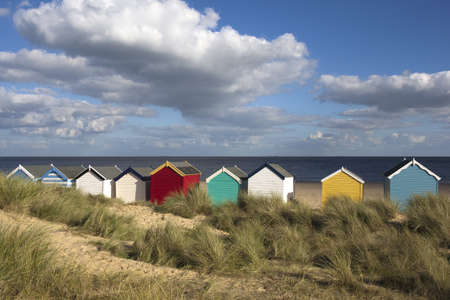 southwold: Beach Huts against a blue sky at Southwold, Suffolk , England Stock Photo