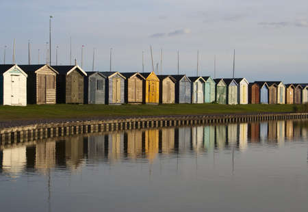 Reflections of Beach Huts at Brightlingsea, Essex, England Stock Photo - 15805028
