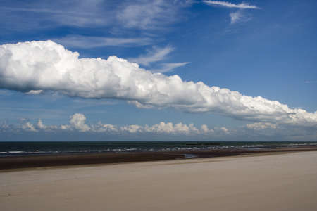 Fluffy white clouds over Dunkirk beach, France Stock Photo - 15843388