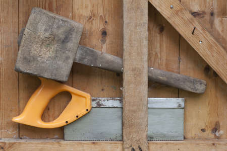 Garden Tools against a shed door photo