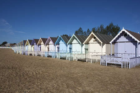 Beach Huts against a blue sky at West Mersea, Essex, England Stock Photo - 17006021