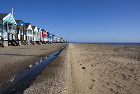 Beach Huts against a blue sky at Southwold, Suffolk , England photo