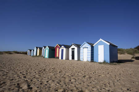 Beach Huts against a blue sky at Southwold, Suffolk , England Stock Photo - 17169930
