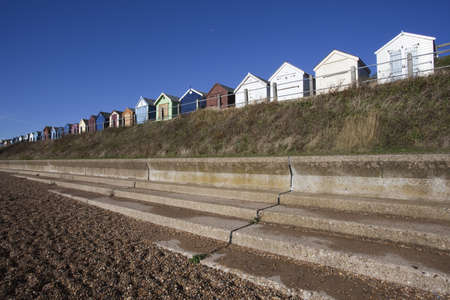 Beach Huts against a blue sky at Felixstowe, Suffolk , England photo