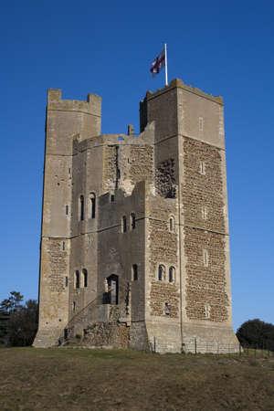 Orford Castle, Suffolk, England against a blue sky